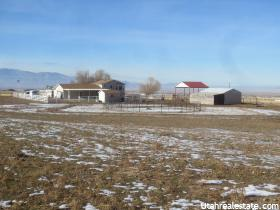 Home for sale at 2128 N Droubay Rd, Erda, UT  84074. Listed at 379000 with 4 bedrooms, 3 bathrooms and 2,323 total square feet