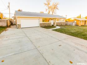 Home for sale at 1924 E Severn Dr, Holladay, UT  84124. Listed at 449900 with 5 bedrooms, 3 bathrooms and 2,716 total square feet
