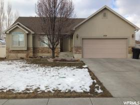 Home for sale at 1424 W 2175 South, Syracuse, UT  84075. Listed at 274900 with 4 bedrooms, 3 bathrooms and 2,476 total square feet
