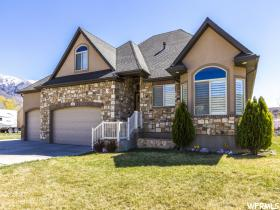 Home for sale at 1717 E 6750 South, Uintah, UT 84405. Listed at 399000 with 5 bedrooms, 4 bathrooms and 4,146 total square feet