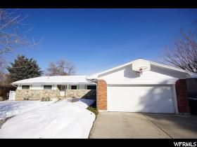 Home for sale at 2801 E Blue Spruce Dr, Holladay, UT  84117. Listed at 614900 with 5 bedrooms, 4 bathrooms and 3,900 total square feet