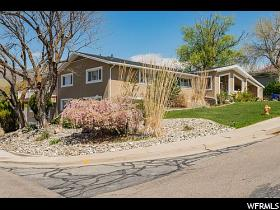 Home for sale at 2551 E Sherwood Dr, Salt Lake City, UT  84108. Listed at 819000 with 6 bedrooms, 5 bathrooms and 5,980 total square feet