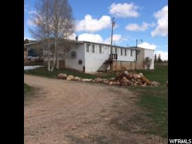 Home for sale at 120 E Stateline Rd, Manila, UT  84046. Listed at 215000 with 2 bedrooms, 2 bathrooms and 1,768 total square feet