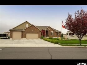 Home for sale at 5817 W 5200 South, Hooper, UT  84315. Listed at 430000 with 6 bedrooms, 4 bathrooms and 3,794 total square feet