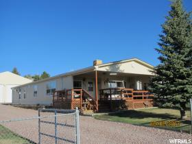 Home for sale at 235 N 5th, Manila, UT  84046. Listed at 249900 with 2 bedrooms, 2 bathrooms and 1,469 total square feet
