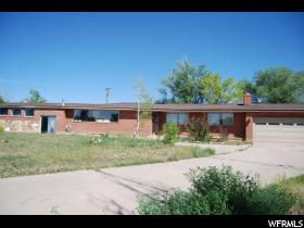 Home for sale at 1068 W Bonnie Dr, Roosevelt, UT  84066. Listed at 190000 with 4 bedrooms, 3 bathrooms and 5,817 total square feet