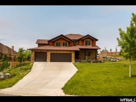 Home for sale at 2597 E 6500 South, Uintah, UT  84403. Listed at 515000 with 6 bedrooms, 4 bathrooms and 4,858 total square feet