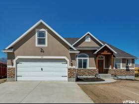 Home for sale at 163  Race St, Grantsville, UT 84029. Listed at 399000 with 3 bedrooms, 2 bathrooms and 3,570 total square feet