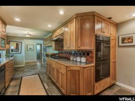 Home for sale at 4003 S 2000 East, Holladay, UT  84124. Listed at 494900 with 4 bedrooms, 2 bathrooms and 2,960 total square feet