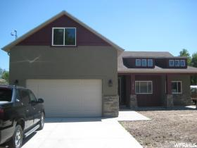 Home for sale at 1410 E 4080 South, Salt Lake City, UT  84124. Listed at 518000 with 4 bedrooms, 3 bathrooms and 2,399 total square feet