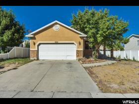 Home for sale at 5857 S Stone Flower Way, Kearns, UT  84118. Listed at 249800 with 4 bedrooms, 2 bathrooms and 2,697 total square feet