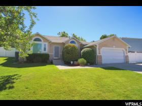 Home for sale at 11719 S Canberra Dr, Sandy, UT  84094. Listed at 354900 with 4 bedrooms, 4 bathrooms and 2,818 total square feet