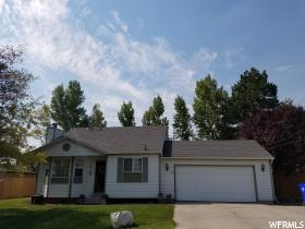 Home for sale at 16 E Durfee St, Grantsville, UT  84029. Listed at 199900 with 4 bedrooms, 2 bathrooms and 1,632 total square feet