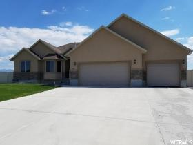 Home for sale at 816 E Deep Wash Rd, Grantsville, UT  84029. Listed at 349900 with 6 bedrooms, 3 bathrooms and 3,700 total square feet