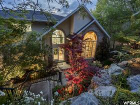 Home for sale at 2426 S Summit Cir, Salt Lake City, UT 84109. Listed at 899999 with 5 bedrooms, 4 bathrooms and 4,978 total square feet