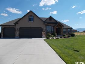 Home for sale at 208 E Mountain Meadow Dr, Grantsville, UT  84029. Listed at 419900 with 3 bedrooms, 2 bathrooms and 4,200 total square feet
