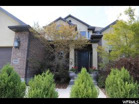 Home for sale at 2104 E Pleasant Valley Ct, Sandy, UT 84092. Listed at 617000 with 6 bedrooms, 4 bathrooms and 4,146 total square feet