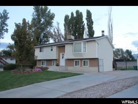 Home for sale at 2440 W 6050 South, Roy, UT  84067. Listed at 214900 with 4 bedrooms, 2 bathrooms and 2,086 total square feet