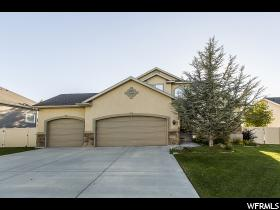 Home for sale at 6433 S Uintah Peak Dr, Taylorsville, UT  84129. Listed at 398888 with 4 bedrooms, 4 bathrooms and 2,759 total square feet