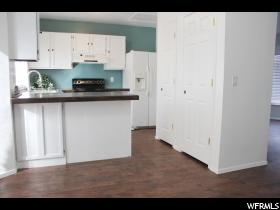 Home for sale at 6028 S Park Wood Dr, Kearns, UT 84118. Listed at 199999 with 3 bedrooms, 1 bathrooms and 1,392 total square feet