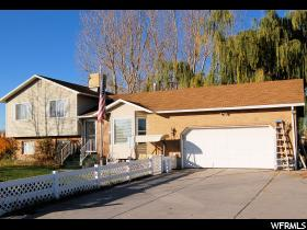 Home for sale at 5035 S 6150 West, Hooper, UT  84315. Listed at 289700 with 4 bedrooms, 2 bathrooms and 2,022 total square feet