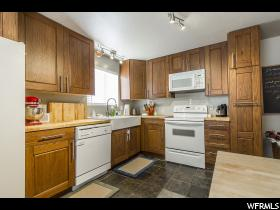 Home for sale at 576 E 10315 South, Sandy, UT  84070. Listed at 259900 with 4 bedrooms, 2 bathrooms and 1,883 total square feet