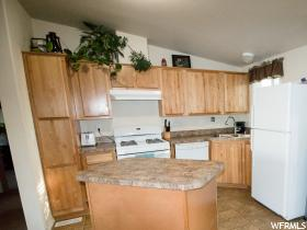 Home for sale at 1005 W 450 North #1, Clearfield, UT  84015. Listed at 49000 with 3 bedrooms, 2 bathrooms and 1,152 total square feet