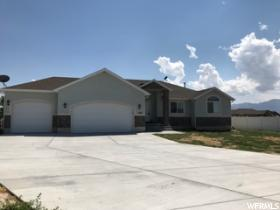 Home for sale at 802 E Saddle Ranch Cir, Grantsville, UT 84029. Listed at 365000 with 3 bedrooms, 2 bathrooms and 3,385 total square feet