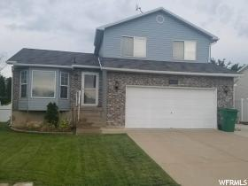 Home for sale at 4180 Lily Dr, Roy, UT  84067. Listed at 229900 with 3 bedrooms, 2 bathrooms and 1,799 total square feet