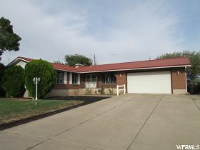 Home for sale at 1415 S 1250 East, Clearfield, UT  84015. Listed at 270000 with 4 bedrooms, 3 bathrooms and 3,228 total square feet