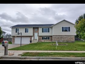 Home for sale at 1126 N 750 West, Clinton, UT  84015. Listed at 299000 with 4 bedrooms, 3 bathrooms and 3,069 total square feet
