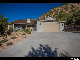 Home for sale at 1977 Chekshani Rd, New Harmony, UT  84757. Listed at 398000 with 3 bedrooms, 2 bathrooms and 2,261 total square feet