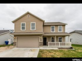 Home for sale at 144 N Century Dr, Ogden, UT  84404. Listed at 260000 with 4 bedrooms, 3 bathrooms and 1,412 total square feet