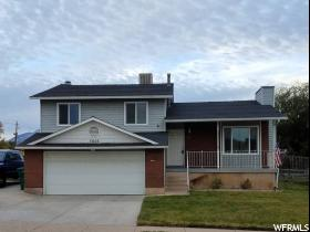 Home for sale at 5606 S 2950 West, Roy, UT  84067. Listed at 229900 with 4 bedrooms, 2 bathrooms and 2,108 total square feet