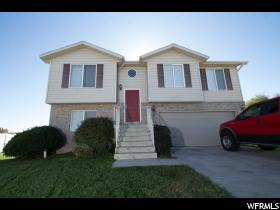 Home for sale at 4033 W 4700 South, Roy, UT  84067. Listed at 200000 with 4 bedrooms, 2 bathrooms and 1,436 total square feet