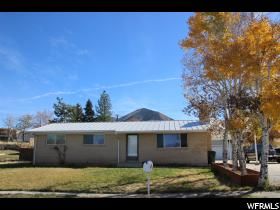 Home for sale at 309 S 7th St, Tooele, UT  84074. Listed at 240000 with 4 bedrooms, 3 bathrooms and 2,648 total square feet