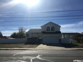 Home for sale at 8013 W 3100 South, Magna, UT  84044. Listed at 265000 with 4 bedrooms, 2 bathrooms and 1,762 total square feet