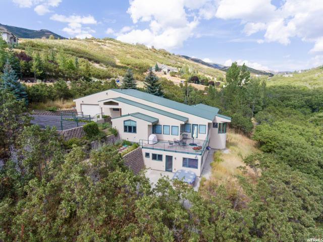 Home for sale at 5586 E Pioneer Fork Rd, Salt Lake City, UT  84108. Listed at 949000 with 4 bedrooms, 4 bathrooms and 5,034 total square feet