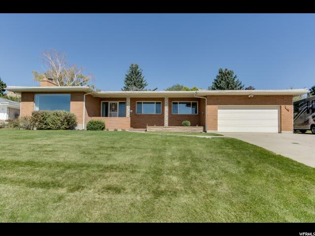 Home for sale at 141 E Edgecombe Dr., Salt Lake City, UT  84103. Listed at 624999 with 4 bedrooms, 3 bathrooms and 3,216 total square feet