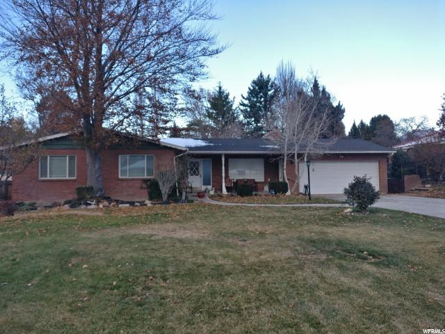 Home for sale at 2047 E Marwood, Holladay, UT  84124. Listed at 564900 with 6 bedrooms, 3 bathrooms and 3,610 total square feet