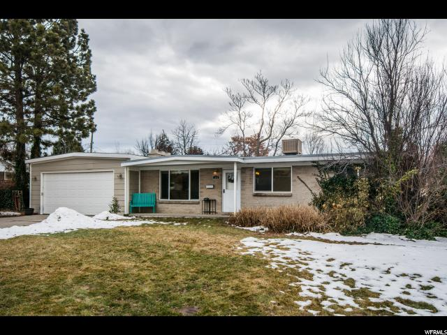 Home for sale at 1240 E Cutler Rd, Salt Lake City, UT  84106. Listed at 355000 with 4 bedrooms, 3 bathrooms and 2,354 total square feet