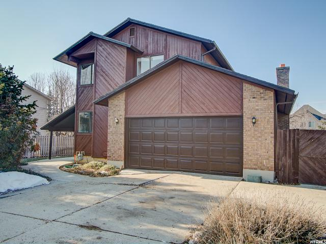 Home for sale at 4460 S Ashford Dr, Millcreek, UT 84124. Listed at 399000 with 4 bedrooms, 3 bathrooms and 3,638 total square feet