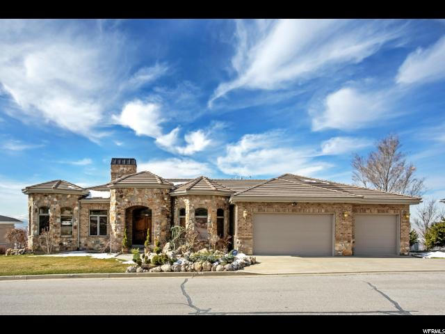 Home for sale at 899 N Sandhurst Dr, Salt Lake City, UT  84103. Listed at 1175000 with 5 bedrooms, 6 bathrooms and 6,339 total square feet