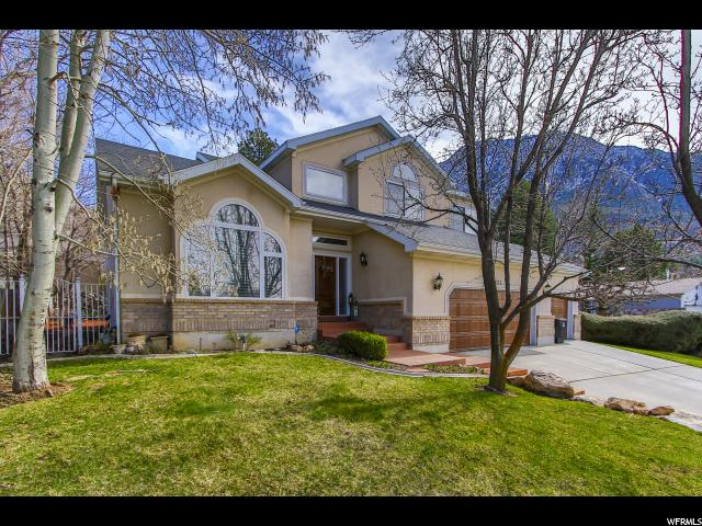 Home for sale at 4325 S Mulholland, Millcreek, UT  84124. Listed at 750000 with 6 bedrooms, 4 bathrooms and 4,287 total square feet