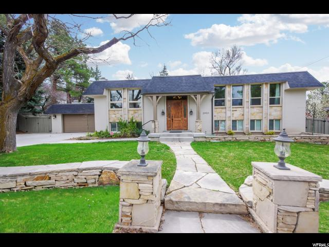Home for sale at 2450 E Lincoln Ln, Holladay, UT 84124. Listed at 565000 with 6 bedrooms, 3 bathrooms and 3,066 total square feet