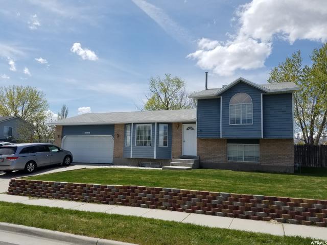 Unique la famille pour l Vente à 6032 S COPPER CITY Drive Kearns, Utah 84118 États-Unis