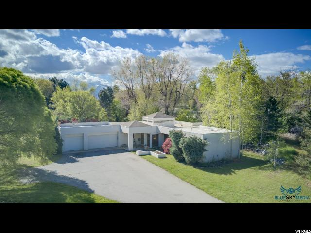 Single Family for Sale at 5835 S JORDAN CANAL Road Taylorsville, Utah 84129 United States