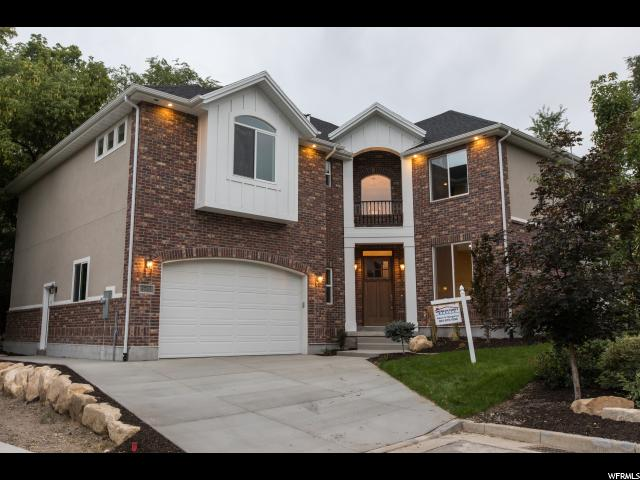 Home for sale at 4743 E Hiddenwoods Ln, Murray, UT 84107. Listed at 799000 with 4 bedrooms, 3 bathrooms and 4,518 total square feet