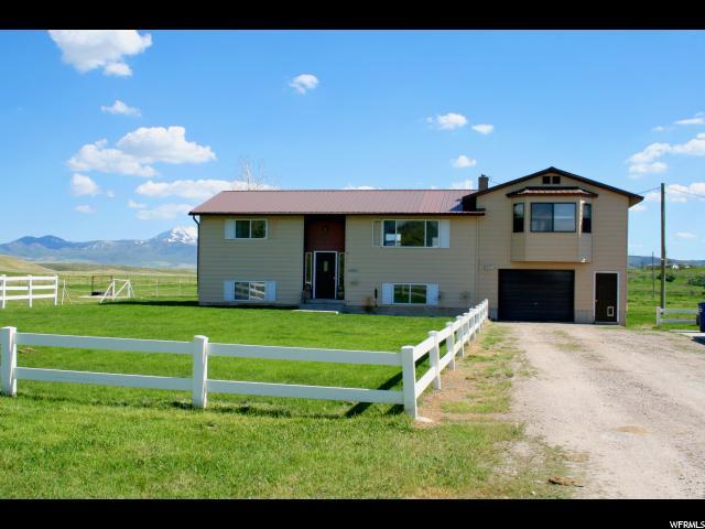 单亲家庭 为 销售 在 1280 E WOODLAND Downey, 爱达荷州 83234 美国