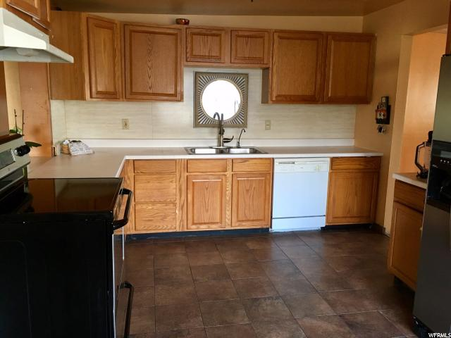 Additional photo for property listing at 3836 S MANHATTEN Drive 3836 S MANHATTEN Drive West Valley City, Utah 84120 United States